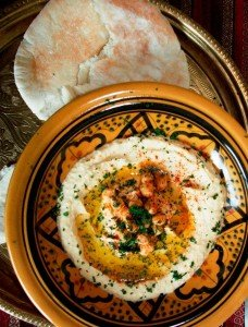 Arabic zeal recipe hummus serve by spreading the hummus on a shallow serving bowl or plate swirl the hummus to make a moat place the reserved chickpeas in the center forumfinder Choice Image