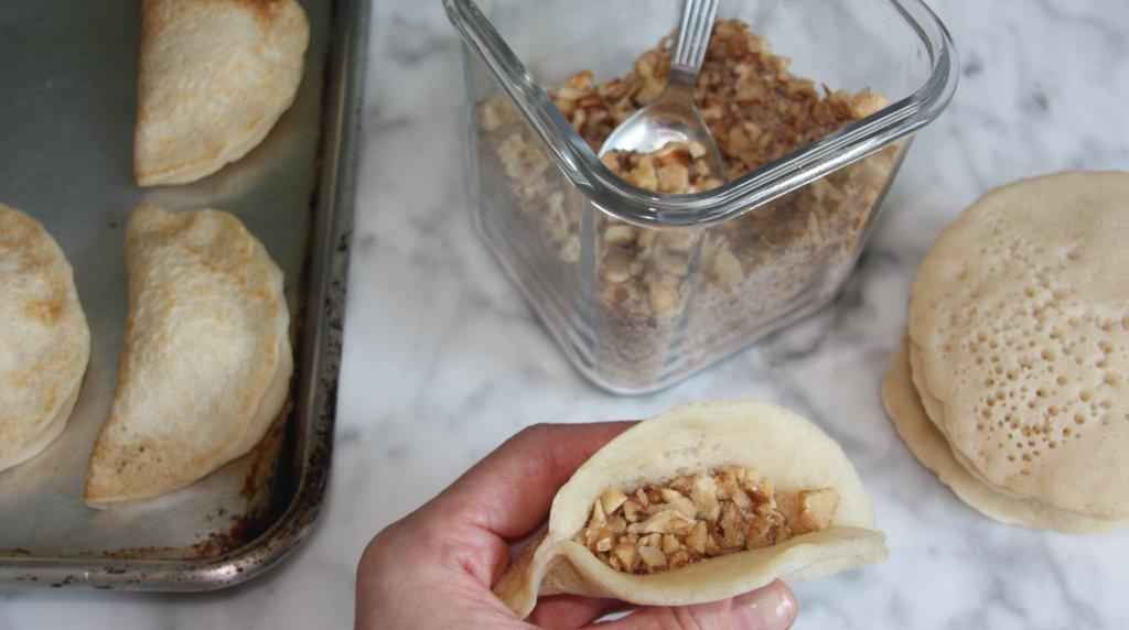 8  Bake stuffed pancakes in a  Qatayef